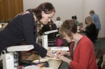 Instructor helping a student at the Bead and Button Show