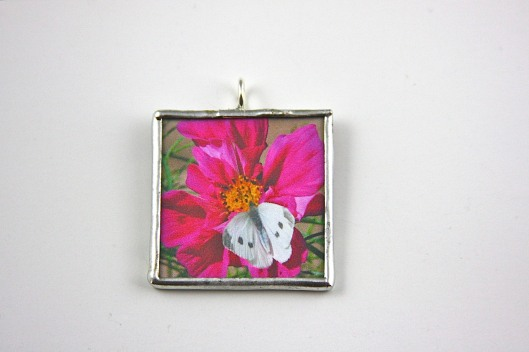 A consistently white background is achieved by using white foam core poster board. Pendant by Suzann Sladcik Wilson