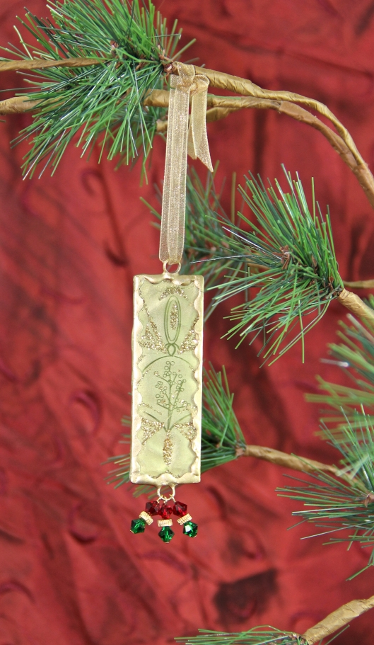 Wrapped Up In Gold Ornament by Suzann Sladcik Wilson